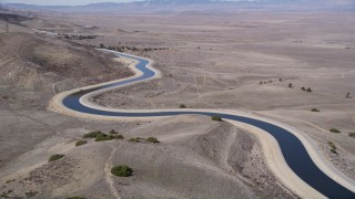 AX0005_060 - 5K stock footage aerial video fly over the California Aqueduct in the desert in California