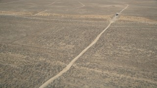 AX0005_066 - 5K stock footage aerial video orbit dirt road in the desert in Antelope Valley, California