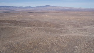 AX0005_071 - 5K stock footage aerial video fly over small desert hills toward solar energy array in Antelope Valley