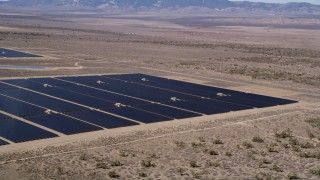 AX0005_076 - 5K stock footage aerial video of a solar panel array in the desert of Antelope Valley, California
