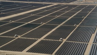 AX0005_078 - 5K stock footage aerial video orbit massive solar energy array in the desert of Antelope Valley, California