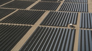 AX0005_079 - 5K stock footage aerial video of an orbit of solar array panels in the desert of Antelope Valley, California