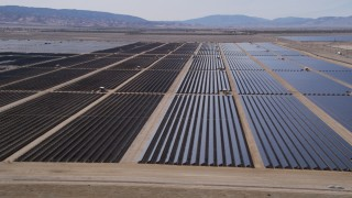 AX0005_081 - 5K stock footage aerial video of desert solar panel array in Antelope Valley, California
