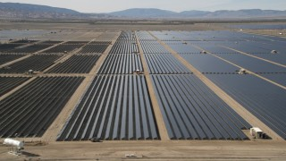 AX0005_081E - 5K stock footage aerial video of desert solar panel array in Antelope Valley, California