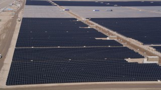 AX0005_088 - 5K stock footage aerial video of circling solar panels at a solar energy farm in the Mojave Desert, California