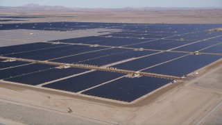 AX0005_091 - 5K stock footage aerial video orbit of a solar energy array in the Mojave Desert, California