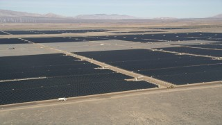 AX0005_092 - 5K stock footage aerial video orbiting Mojave Desert solar energy array in California