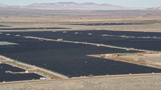 AX0005_093 - 5K stock footage aerial video orbit AV Solar Ranch One in the Mojave Desert, California