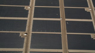 AX0005_104 - 5K stock footage aerial video of a bird's eye view of large solar energy array in the Antelope Valley, California