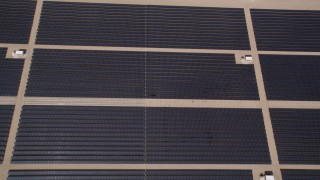 AX0005_106 - 5K stock footage aerial video of bird's eye of Mojave Desert solar energy array in California