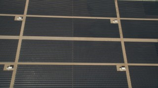 AX0005_106E - 5K stock footage aerial video of bird's eye of Mojave Desert solar energy array in California