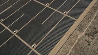 AX0005_108 - 5K stock footage aerial video of bird's eye orbit of Mojave Desert solar energy array in California