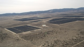 AX0005_115 - 5K stock footage aerial video of a large solar energy array in the Mojave Desert, California