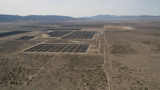 AX0005_117 - 5K stock footage aerial video flyby Mojave Desert solar energy array in California