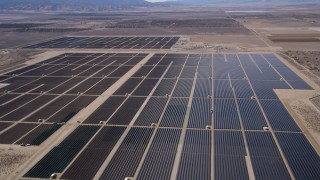 AX0005_119 - 5K stock footage aerial video approach and fly over Mojave Desert solar energy array in California