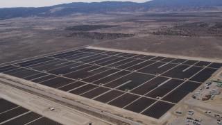AX0005_121 - 5K stock footage aerial video orbit solar energy array in the Mojave Desert, California