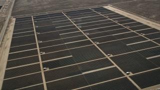 AX0005_121E - 5K stock footage aerial video orbit solar energy array in the Mojave Desert, California