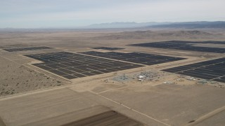 AX0005_123 - 5K stock footage aerial video orbiting a massive desert solar energy array in Antelope Valley, California