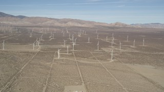 AX0005_124 - 5K stock footage aerial video approach a field of windmills in the Mojave Desert, California