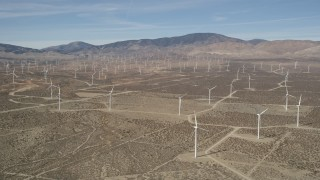 AX0005_125 - 5K stock footage aerial video of a field of windmills in the Mojave Desert, California