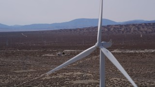 AX0005_132 - 5K stock footage aerial video orbit windmill at an Antelope Valley wind farm in California