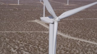 AX0005_137 - 5K stock footage aerial video of a tight orbit of the top of a windmill in the California Desert