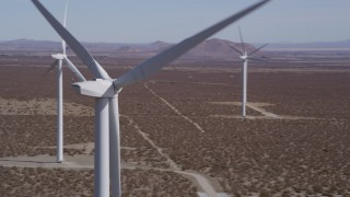 AX0005_138 - 5K stock footage aerial video of a tight orbit around the blades of a windmill in the California Desert