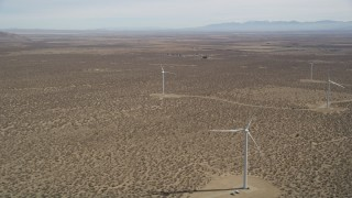 AX0005_140 - 5K stock footage aerial video of a small group of windmills at a Mojave Desert wind farm in California