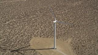 AX0005_141 - 5K stock footage aerial video orbit lone windmill in the California Desert