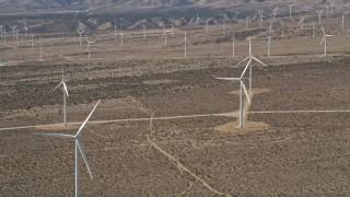 AX0005_142 - 5K stock footage aerial video orbiting a wind farm in the California Desert