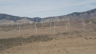 AX0005_144 - 5K stock footage aerial video approach wind farm windmills in the desert of Antelope Valley, California