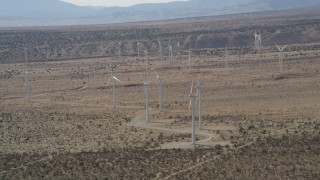 AX0005_145 - 5K stock footage aerial video circle a group of Mojave Desert windmills in Antelope Valley, California