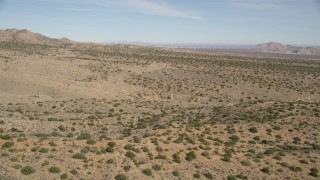 AX0005_147 - 5K stock footage aerial video of flying low over open desert in Antelope Valley, California