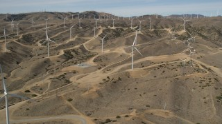 AX0006_020E - 5K stock footage aerial video of approaching a field full of windmills at a desert wind farm in Antelope Valley, California