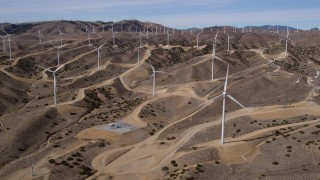 AX0006_021 - 5K stock footage aerial video approach several windmills at desert wind farm in Antelope Valley, California