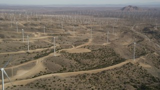 AX0006_027 - 5K stock footage aerial video of a large desert wind farm in Antelope Valley, California