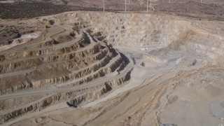 AX0006_034 - 5K stock footage aerial video orbit a desert quarry pit in Antelope Valley, California