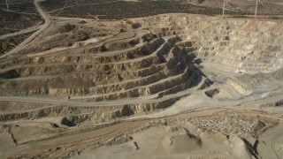 AX0006_034E - 5K stock footage aerial video orbit a desert quarry pit in Antelope Valley, California