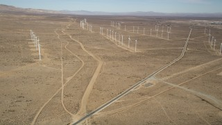 AX0006_048 - 5K stock footage aerial video approach three rows of windmills at a wind energy farm in the California desert