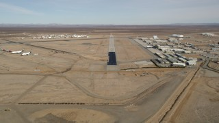 AX0006_054 - 5K stock footage aerial video approach runway at Mojave Air and Space Port in California