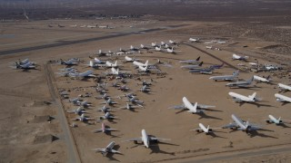 AX0006_060 - 5K stock footage aerial video orbit around an aircraft boneyard in the desert, Mojave Air and Space Port, California