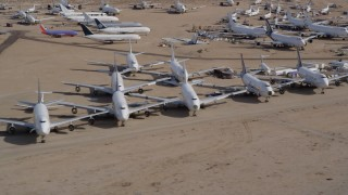 AX0006_066 - 5K stock footage aerial video of rows of airplanes at an aircraft boneyard in the Mojave Desert, California