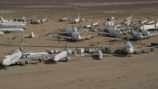 AX0006_066E - 5K stock footage aerial video of rows of airplanes at an aircraft boneyard in the Mojave Desert, California