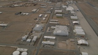 AX0006_091 - 5K stock footage aerial video orbit hangars and runways at the Mojave Air and Space Port in California