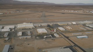 AX0006_093E - 5K stock footage aerial video orbit a row of hangars and runways at Mojave Air and Space Port, California