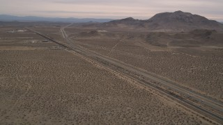 AX0006_098 - 5K stock footage aerial video approach Highway 14 in the Mojave Desert, California