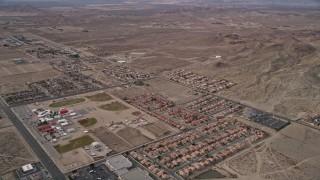 AX0006_101 - 5K stock footage aerial video of small desert neighborhoods in Rosamond, California