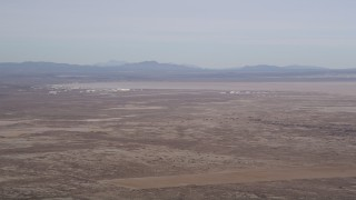 AX0006_108 - 5K stock footage aerial video of Edwards Air Force Base and Rogers Dry Lake in the Mojave Desert, California