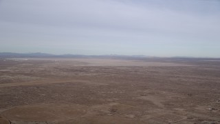 AX0006_109 - 5K stock footage aerial video of Edward Air Force Base and dry lake in the Mojave Desert, California