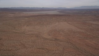 AX0006_123 - 5K stock footage aerial video of VFX Background Plate of dry lake in the Mojave Desert, California